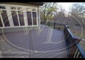 Palos Park, IL  - Decking: Trex Transcend Spiced Rum - Posts: Trex Transcend Vintage Lantern - Railing: Trex Black Railing - Balusters: Black Square Aluminum - Lighting: Riser Lights