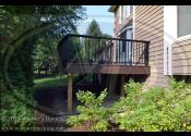 Woodridge IL 60517  Radius Deck Trex Transcends Spiced Rum Decking Trex Transcends Spiced Rum Border Trex Signature Black Square Aluminum Railing Trex Transcends Vintage Lantern Fasica and Risers Trex 1x6 Spiced Rum Cocktail Rail