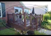 Bolingbrook, IL - Decking: Trex Transcend Spiced Rum - Fascia: Trex Transcend Spiced Rum - Railing & Posts: Trex Transcend Vintage Lantern - Balusters: Trex Tree House - Lighting: Riser Lights