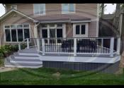 Downers Grove, IL  Trex Transcend Island Mist Decking Trex Transcend White Railings Trex Transcend Island Mist Cocktail Railing Trex Black Aluminum Balusters