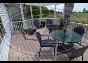 Plainfield, IL 60544 - Decking: Trex Transcend Rope Swing - Boarder: Trex Transcend Spiced Rum - Railing, Balusters, Posts, Caps, & Pergola: Trex Transcend White