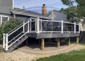 Downers Grove, IL 60516 - Decking: Trex Transcend Island Mist - Boarder & Fascia: Trex Transcend Island Mist Railing & Posts: Trex White - Balusters: Black Square Aluminum